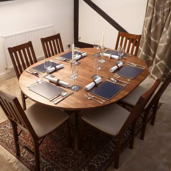 Extending Dining Table in 'dining' format set for six diners