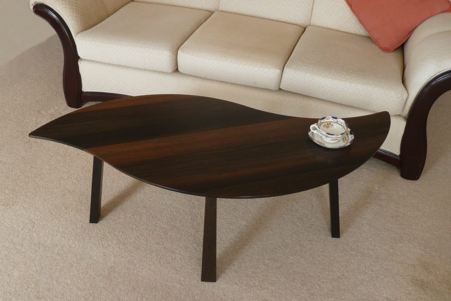 Single leaf of Bog Oak Double Leaf Coffee Table, next to sofa