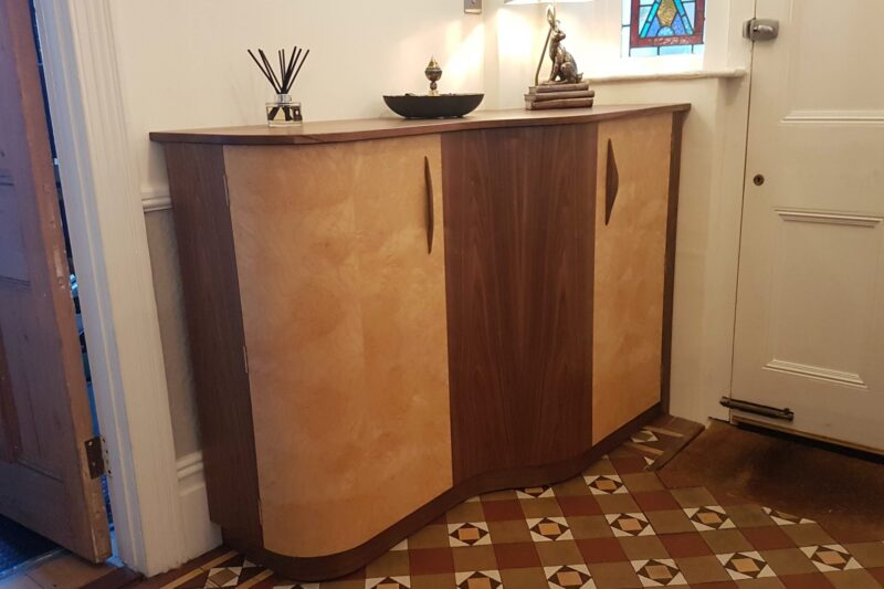 Bespoke Hall Cabinet after installation with ornaments on top