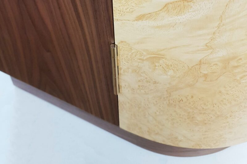 Hall Cabinet - detail of polished nickel hinge at base of curved door
