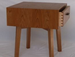 Wrap around cherry wood on bedside table
