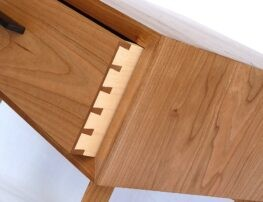 Showing close-up of dovetailed drawers