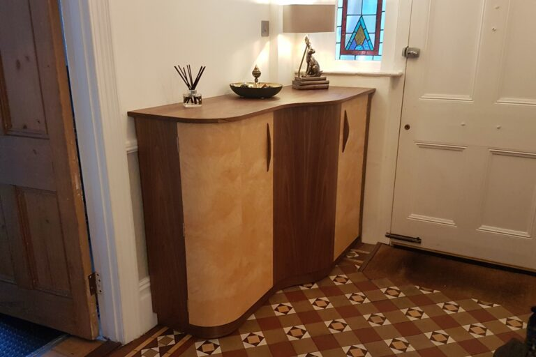 Photograph of curved cabinet installed in hallway