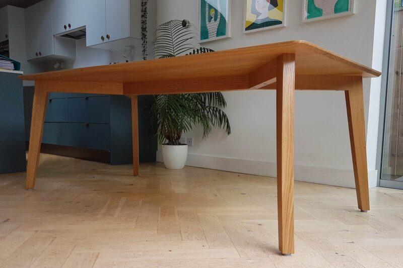Showing Y-shaped under-frame of bespoke oak dining table